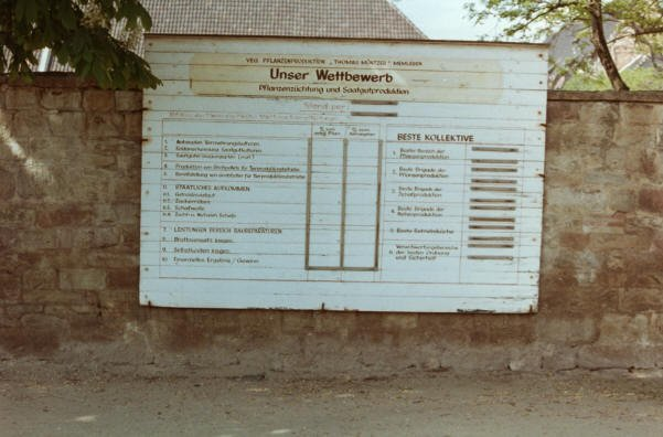 'Unser Wettbewerb', our competition. I took a photograph of this notice in the village of Memleben in Saxony-Anhalt in May 1986. It shows the results of which groups were doing well in the various collectives in the local vegetable and seed-growing plant. At a conference dinner in Halle hosted by leading local dignitaries, we were all surprised by their candid admission concerning the failures of collectivisation. If we are shocked by such valuing of work, perhaps we should consider why that is the case.