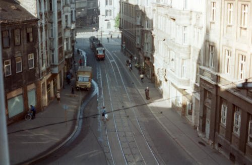 A photo of one of the main roads in the centre of Halle, taken from my hotel window in May 1986. Oblivious of the light and shade, a beautiful, Czech-built tram moves quietly through a street largely empty of pedestrians, awakening a certain eeriness about the scene.