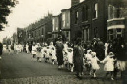 Whitsun Walk, Westhoughton, Bolton, in 1926. Once a year, as this contemporary postcard reveals, Lancashire Catholics, complete with frocks and banners, took to the streets in a show of devotion.